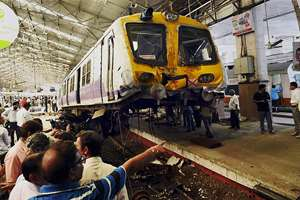 A Mumbai local train derails from the platform after the driver lost control at Churchgate station in Mumbai.