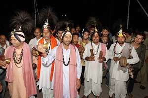Devotees shout religious slogans as they begin their pilgrimage to the Amarnath shrine, in Jammu.