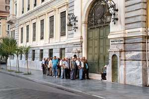 Pensioners line up as they wait to be allowed into a bank to withdraw a maximum of 120 euros ($134) for the week. Greece braced for more chaos on the streets outside its mostly shuttered banks, as Athens and its creditors halted talks on resolving the country's deepening financial crisis until a referendum this weekend.