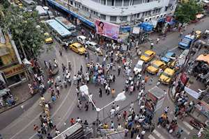 Congress activists block a road in Kolkata during a protest against the State Government for allegedly heckling a professor and non-teaching staff of Calcutta University (CU), in Kolkata.