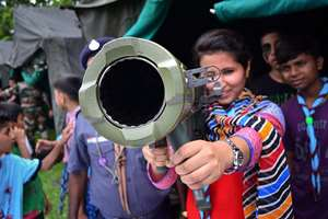 A student having a look of a rocket launcher at an exhibition organised by the Indian Army at Boko in Kamrup district of Assam.
