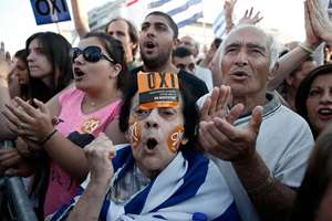 An elderly demonstrator with stickers reading ''No'' on her face shouts slogans during a rally organised by supporters of the No vote in Athens. A new opinion poll shows a dead heat in Greece's referendum campaign with just two days to go before Sunday's vote on whether Greeks should accept more austerity in return for bailout loans.