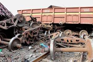 Derailed coaches of a goods train after collision with a truck in Purulia district in West Bengal.