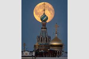 The moon rises above the Saviour of Spilled Blood Cathedral in downtown St. Petersburg, Russia.