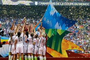 The United States Women's National Team celebrates with the trophy as confetti falls after they beat Japan 5-2 in the FIFA Women's World Cup soccer championship in Vancouver, British Columbia, Canada.