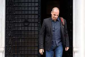 File: Greek Finance Minister Yanis Varoufakis leaves Maximos Mansion in Athens. Varoufakis resigned saying he was told shortly after the Greek referendum result that the some eurozone finance ministers and Greece's other creditors would prefer he not attend the ministers' meetings.