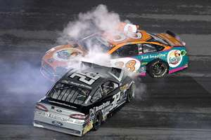 Bobby Labonte (32) collides with David Gilliland (38) in a multi-car accident during a NASCAR Sprint Cup series auto race at Daytona International Speedway in Daytona Beach, Florida.