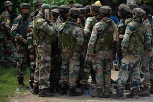 Army take instructions from a higher commander during a fight in the town of Dinanaga, in Punjab. Army commandos joined police in fighting suspected militants who fired at a bus station and stormed into police barracks on the outskirts of a town bordering Pakistan.