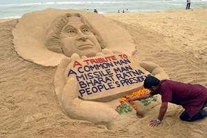 Sand artist Sudarsan Pattnaik creates a sand sculpture to pay tribute to former President APJ Abdul Kalam, at Puri beach, in Odisha.