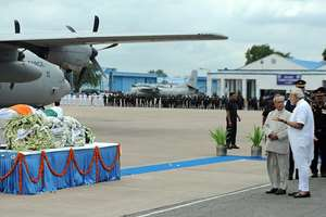 President Pranab Mukherjee and Prime Minister Narendra Modi at Air Force Station for paying homage at the mortal remains of the former President of India, Dr. A.P.J. Abdul Kalam, in New Delhi.