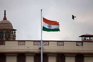 India's flag is flown at half-mast at the Parliament House as a mark of respect for former President A.P.J. Abdul Kalam who died at the age of 83, in New Delhi.