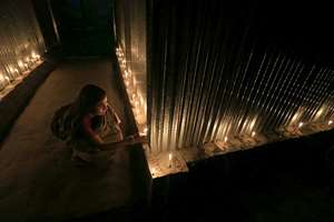 A woman lights candles in celebration at Dashiachora, in Kurigram enclaves, Bangladesh. At the stroke of midnight, tens of thousands of stateless people who were stranded for decades along the poorly defined border between India and Bangladesh will finally get to choose their citizenship, as the two countries swapped more than 150 pockets of land to settle the demarcation line dividing them.
