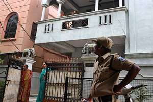 A policeman stands outside the residence of one of the four Indian nationals who was detained near the Libyan city of Sirte, in Hyderabad. Four Indian teachers, who were returning to India from Tripoli and Tunis, have been kidnapped in Libya, allegedly by the Islamic State terror group (IS).