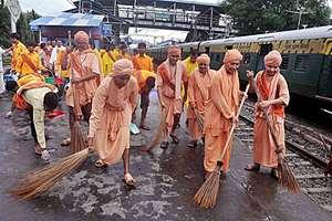 Swami Biswatmananda (2nd R), General Secretary, Bharat Sevashram Sangha, with monks and volunteers of the Sevashram take part in Swachh Bharat Abhiyan at Ballygunge station in Kolkata,West bengal.