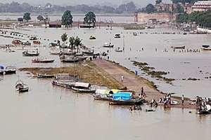 People cross Ganga river after heavy monsoon rains in Allahabad, Uttar Pradesh.