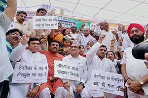 Delhi Congress President Ajay Maken with party workers on protest in East Delhi.