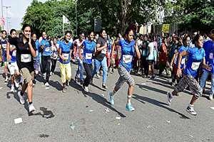 Participants run in the 2nd Women Marathon in New Delhi.