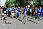 Participants run in the 2nd Women Marathon in New Delhi.
