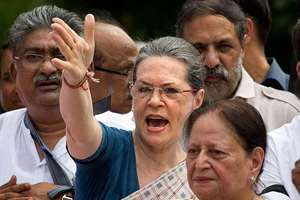 Congress party president Sonia Gandhi, centre, and other Congress party lawmakers shout slogans against the government during a protest in the parliament premises, in New Delhi.