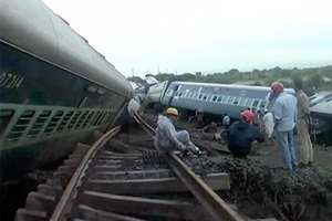 People gather by the twisted track alongside two derailed trains in Harda in Madhya Pradesh.