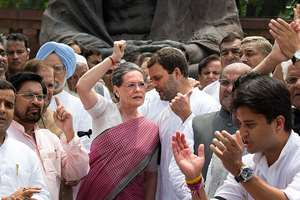 Congress party president Sonia Gandhi, center left, with vice president Rahul Gandhi, as she shouts slogans against the government during a protest in the parliament premises in New Delhi.