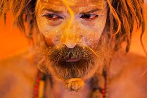 A Naga sadhu pauses inside a tent during Kumbh Mela, at Trimbakeshwar, in Nasik. The festival is held four times every 12 years.