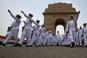 Soldiers leave after a ceremony to honor soldiers killed in action on occasion of 50th anniversary of India's win over Pakistan in the war of 1965, at the India Gate war memorial in New Delhi.