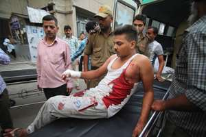 An injured civilian of cross border firing gets down from an ambulance at the Government Medical College hospital in Jammu, J&K.