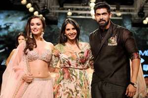 Actor Rana Daggubati with actress Amy Jackson (L) as they display the creation of fashion designer Anushree Reddy (centre) during the Lakme Fashion Week/ Winter Festive 2015, in Mumbai.
