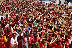 People participate in the Adi festival in Ooty.