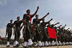 Newly inducted Indian army soldiers march during their passing-out parade ceremony in Bangalore.