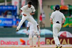 India's Umesh Yadav celebrates taking the wicket of Sri Lanka's Dimuth Karunarathne, unseen, on day four of the third test cricket match between them in Colombo, Sri Lanka.