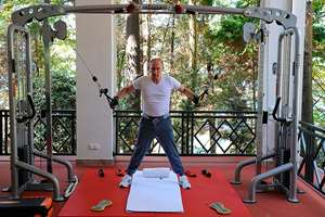 Russian President Vladimir Putin exercises during his meeting with Prime Minister Dmitry Medvedev, unseen, at the Black Sea resort of Sochi, Russia.