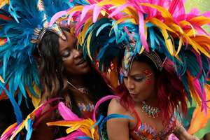 Costumed revellers perform in the Notting Hill Carnival in London. Held each August Bank Holiday since 1966, the Notting Hill Carnival is the largest festival celebration of its kind in Europe.