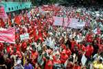 Trade union members take part in a rally  during the nationwide protest and bandh against the Modi government's draft National Road Safety Bill, in Bengaluru.