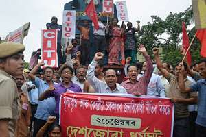 "Activists of the CITU and AITUC stop a train near Guwahati Railway Station during their nationwide strike against the NDA Government's alleged ""anti-worker"" policies, in Guwahati."