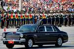Chinese President Xi Jinping stands in a car to review the army during a parade commemorating the 70th anniversary of Japan's surrender during World War II held in front of Tiananmen Gate in Beijing.