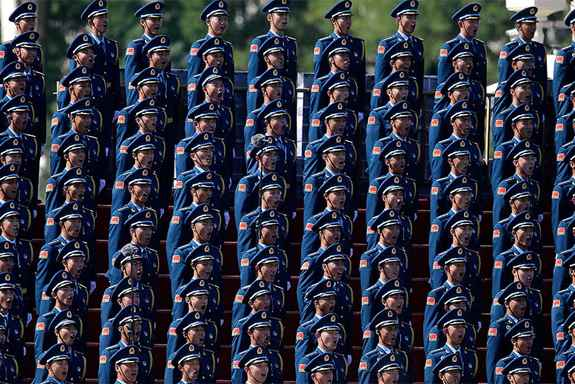 Chinese military personnel sing ahead of a parade commemorating the 70th anniversary of Japan's surrender during World War II held in front of Tiananmen Gate, in Beijing.