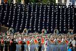 A military band performs prior to the start of a parade commemorating the 70th anniversary of Japan's surrender during World War II held in front of Tiananmen Gate in Beijing.