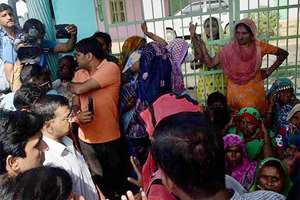 Village women stopping Delhi Chief Minister Arvind Kejriwal from entering Bisara village where Mohd Ikhlaq was recently lynched by a mob, in Dadri.