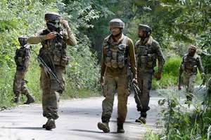 Army Personnels moves towards a house where two Jaish-e-Mohammad militants were hiding during an encounter in which both militants were killed and one security person was injured, at Tral area of south Kashmir.