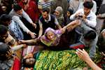 A Kashmiri Muslim woman wails near the body of a suspected militant, during his funeral at Barhama, 40 kilometers (25 miles) south of Srinagar. At least four army soldiers and three suspected militants were killed in three separated gun battles in Kashmir.