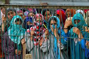 Women wail as they watch the funeral procession of suspected militant killed in a gun battle, at Barhama, 40 kilometers (25 miles) south of Srinagar.