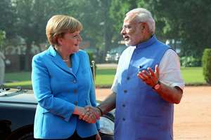 Prime Minister Narendra Modi with German Chancellor Angela Merkel during the ceremonial reception at the forecourt of Rashtrapati Bhawan, in New Delhi.