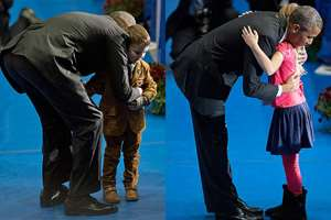 President Barack Obama embraces children as he greets family members and coworkers of fallen firefighters during the National Fallen Firefighters Memorial Service at Mount St. Mary's University's Knott Athletic Recreation Convocation Complex (ARCC) in Emmitsburg, Maryland.