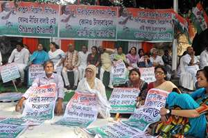 Trinamool Congress activists stage 'Dharna' in front of West Bengal State Election Commission office in protest against the announcement to postpone the counting of Bidhannagar municipal corporation elections, in Kolkata, West Bengal.