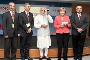 Prime Minister, Narendra Modi and the German Chancellor, Angela Merkel at the Robert Bosch Engineering & Innovation Centre, in Bengaluru.