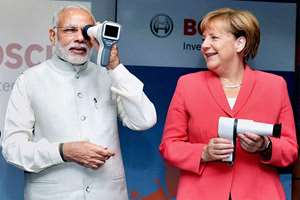 Prime Minister Narendra Modi and the German Chancellor, Angela Merkel at the Robert Bosch Engineering & Innovation Centre, in Bengaluru.