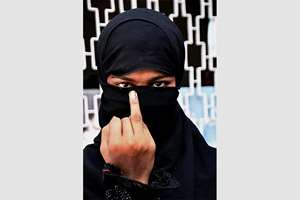 A voter display her inked finger after casting vote for Bihar assembly election, in Begusarai.