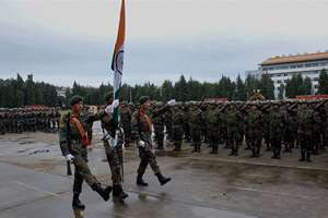Soldiers carry Indian Tricolour during commencement of India-China joint exercise 'Hand-in-Hand 2015' at Kunming Military Academy in Yunnan Province of China.